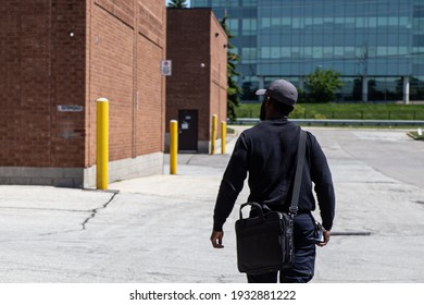 Security guard patrolling around parking lot area