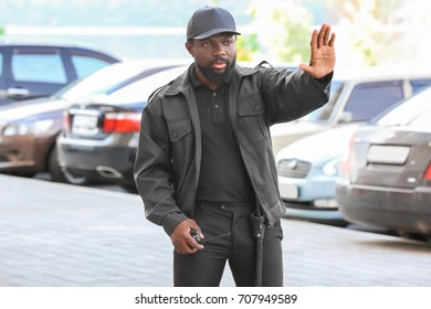 Security guard showing stop gesture outdoors