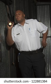 Security guard with torch on duty