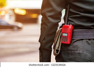 Security guard uses radio communication for facilitate traffic. Traffic Officers use radio communication to maintain order in the parking lot in Thailand.