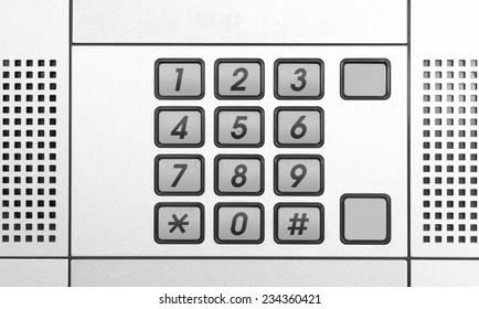 Security intercom number keypad at apartment door
