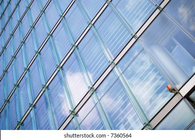 security light at a glassed business building with reflecting sky