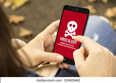security mobile concept: woman holding a 3d generated smartphone with virus alert on the screen. Graphics on screen are made up.