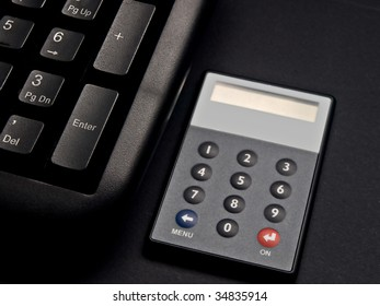 Security net banking token next to keyboard.