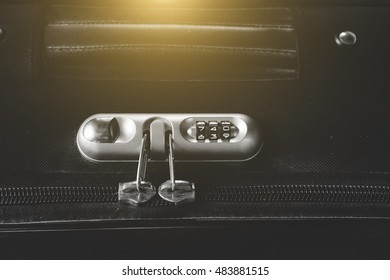 security padlock with three numbers on black suitcase