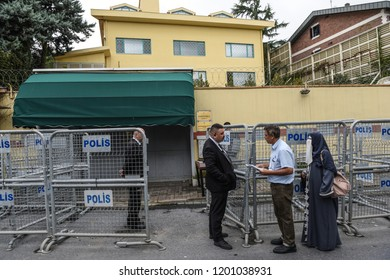 Security personnel check the identity papers of visitors at the entrance of Saudi Arabia's consulate in Istanbul, Friday, Oct. 12, 2018.