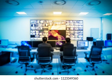 Security staff viewing video in monitoring room