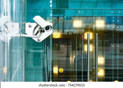 Security surveillance system at the entrance to a modern office building. Two cameras of video surveillance