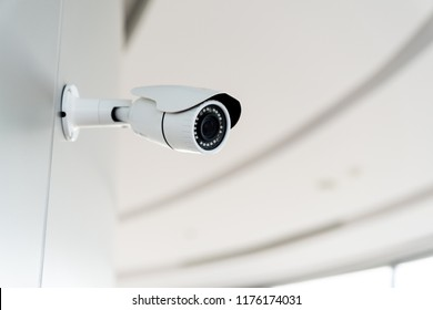 Security white CCTV (Closed-circuit television) camera in the office building.