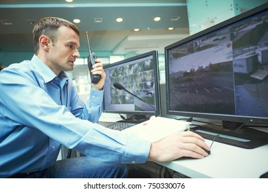 Security worker during monitoring. Video surveillance system.