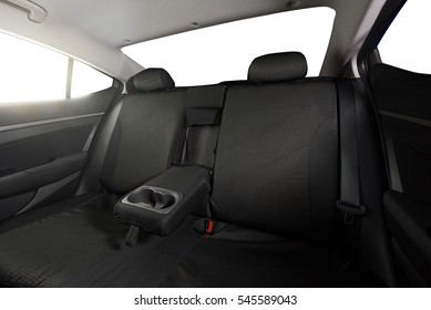 Sedan back black cloth seats with isolated windows