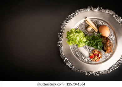 Seder, dinner on the occasion of Passover. Seder plate on a black background