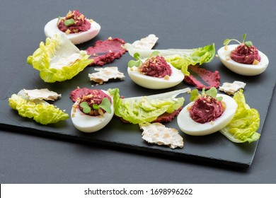 Seder plate plate of hard boiled egg stuffed with Creamy horseradish paste - Horseradish Deviled Eggs