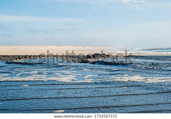 Sediment transposition intervention to the Atlantic Ocean to optimize the hydrodynamic balance in Ovar, Portugal.