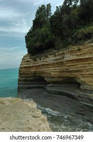 Sedimentary rocks in amazing turquoise blue water, with wonderful layers on Corfu island, Greece
