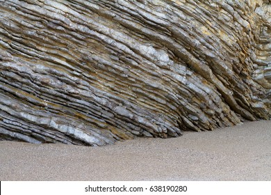 Sedimentary rocks. Natural corrugated stone schistous, background