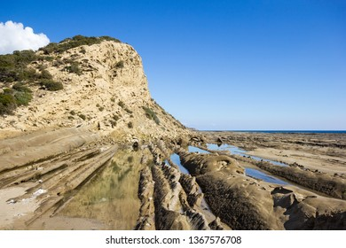 Sedimentary rocks and tide pools at the coastline in Karpas Peninsula, Northern Cyprus