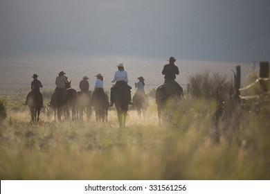 Sedona. Arisona USA - September 16, 2014: Group of cowboys on horseback in Pine Valley at sunrise. Sedona. Arisona