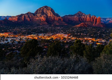 Sedona, Arizona, surrounded by red-rock buttes, steep canyon walls and pine forests, is seen at Sunset from Airport Mesa is seen January 24, 2018.