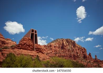 SEDONA, ARIZONA, US - MAY 11 2013: The Chapel of the Holy Cross towering between red rocks on May 11 in Sedona