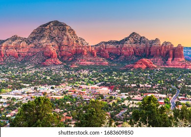 Sedona, Arizona, USA downtown cityscape and mountains.