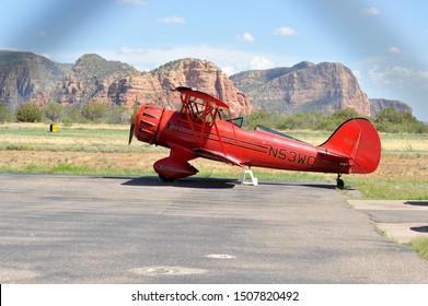 SEDONA, AZ / USA - July 22 2011: Bright red single-engine biplane provides air tours from Sedona Airport in Sedona, Arizona.
