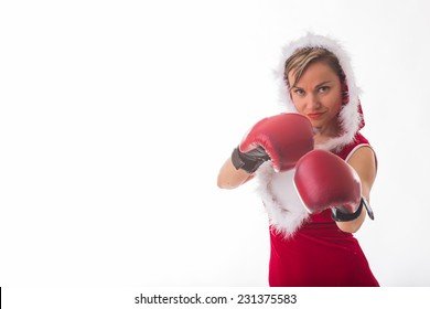 Seductive, athletic blonde in a New Year's suit and red boxing gloves. Sexy girl posing in boxing gloves on a white background. New Year's holidays, sports, boxing - New Year concept of fitness.