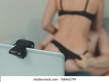 Seductive couple working as webcam models. Virtual sex.