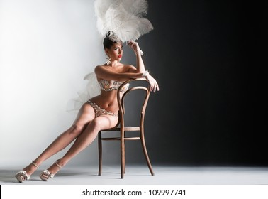 Seductive dancer sitting on the chair