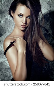 Seductive Fashion Model Girl. Beauty Young Woman Portrait. Dark Long Hair, Tan Bronze Skin.