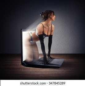 Seductive girl comes out of a laptop
