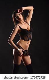 Seductive girl in lingerie on dark background