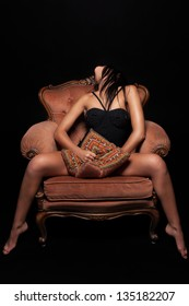 Seductive girl on a throne of pleasure