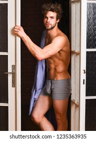 Seductive lover full of desire. Man lover near door. Sexy bachelor lover concept. That was great night. Guy attractive lover posing seductive. Sexy macho tousled hair coming out bedroom door.