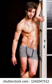 Seductive lover full of desire. Man confident lover near door. Sexy bachelor lover concept. Sexy attractive macho tousled hair coming out through bedroom door. Guy attractive lover posing seductive.