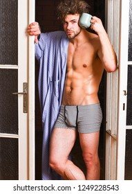 Seductive lover full of desire. Sexy macho tousled hair coming out bedroom door. Man lover near door. Sexy bachelor lover concept. That was great night. Guy attractive lover enjoy morning coffee.
