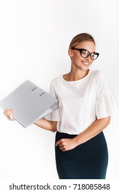 Seductive woman in office suit poses with grey folder