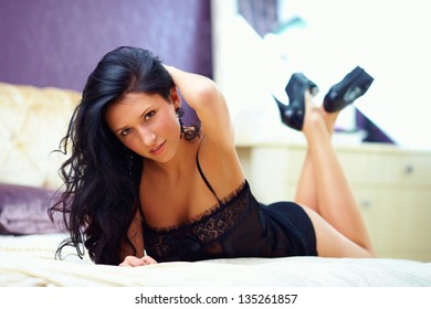 seductive young woman in lingerie, bedroom interior