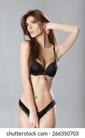 Seductive young woman wearing black lingerie