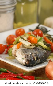 see bream with mediterranean vegetable on a plate