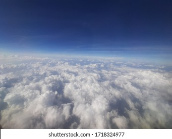 see clouds from the plane window
