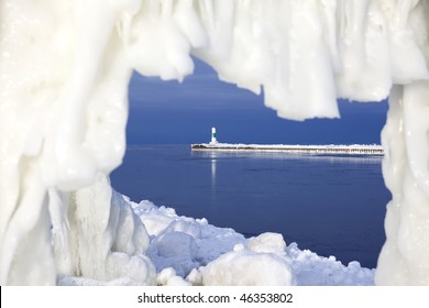 See the lighthouse in Grand Haven in Michigan though an ice hole
