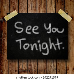 See you tonight note on message note with wooden background