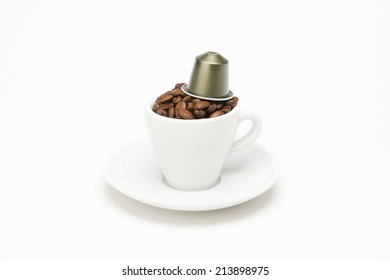 Seed of coffee with capsule on white background