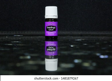Seedlings Calm Young Living Essential Oils Blend on on black granite - San Antonio, Texas, USA - August 18, 2019