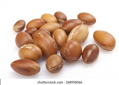 seeds of argan on white,a close up isolated on white