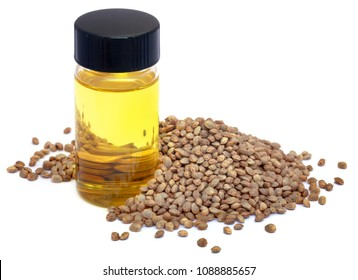 Seeds of Cannabis or hemp with essential oil in bottle