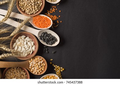 seeds and grains on a dark background