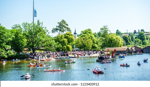 Seehausen, Germany - May 31: a special bavarian corpus christi procession in Seehausen, germany, where the faithful use boats for part of the route on may 31, 2018