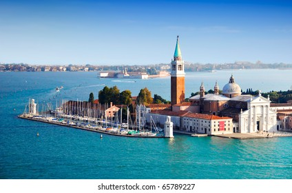 Seeightseeing of a small island in Venice just in front of the Saint Marco plazza under a bright sunny sky.